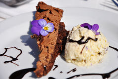 Sticky Brownie with lavender ice-cream Stock Photos