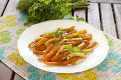 Sticky carrots and parsnip. Fresh sticky carrots and parsnip dish Stock Photo