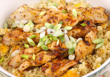 Sticky Chicken with mango couscous Stock Images