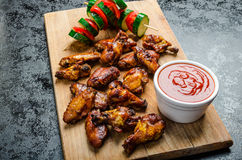 Sticky chicken with red hot dip Stock Photos