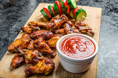 Sticky chicken with red hot dip Royalty Free Stock Photo