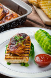 Sticky chicken with spicy sauce, toasted panini Stock Photos