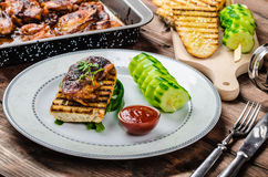 Sticky chicken with spicy sauce, toasted panini Stock Photo