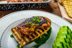 Sticky chicken with spicy sauce, toasted panini Royalty Free Stock Image