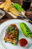 Sticky chicken with spicy sauce, toasted panini Stock Image