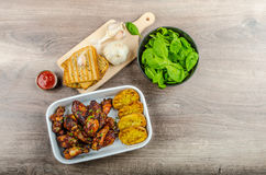 Sticky chicken wings with garlic panini bread Royalty Free Stock Image