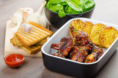 Sticky chicken wings with garlic panini bread Royalty Free Stock Photos