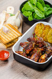 Sticky chicken wings with garlic panini bread Royalty Free Stock Photography