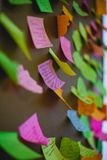 Sticky colored paper on the board. Colored paper with inscriptions on the board Royalty Free Stock Photo