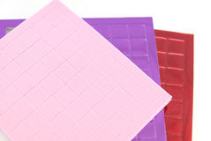 Sticky craft squares. Sticky multicolored soft plastic for child craft Stock Images