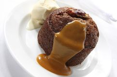 Sticky Date Pudding. With caramel sauce and vanilla icecream Royalty Free Stock Image