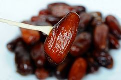 Sticky date on a skewer. Date on the end of a fork/skewer (dried fruit), UK, Western Europe Royalty Free Stock Images
