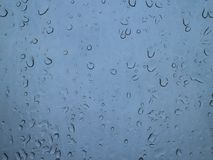 Sticky drops on clear glass. Rain coming late autumn, gray leaden sky Stock Photography