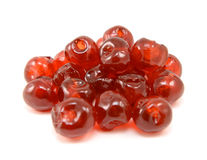 Sticky glace cherries. Isolated on a white background Royalty Free Stock Image