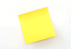 Sticky Note. An isolated yellow sticky note on white background stock photography