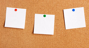 Sticky note. Hanging on corkboard stock images