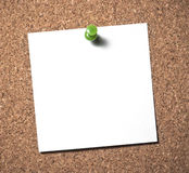 Sticky note. Blank paper push pin note on cork board Royalty Free Stock Image