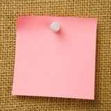 Sticky Note. Attached to bulletinboard Stock Photos