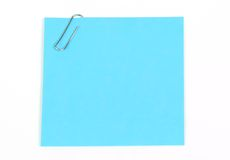 Sticky note. Isolated blue sticky note with paperclip stock photo