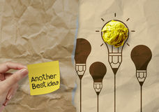 Sticky note another best idea on crumpled paper background Stock Image