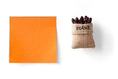 Sticky note and beans in a packet Stock Photos