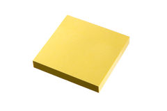 Sticky note block with clipping path. Blank yellow sticky note block is isolated on white background Royalty Free Stock Photography