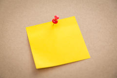 Sticky note on board. On background Royalty Free Stock Photography