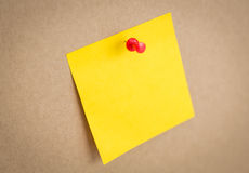 Sticky note on board. On background Stock Images