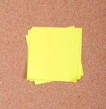 Sticky note on a bulletin board Stock Photo