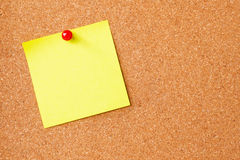 Sticky note on cork board Stock Images