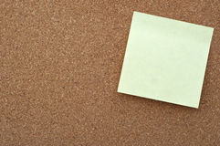 Sticky note on cork board Stock Image
