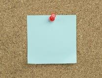 Sticky note. On cork board background royalty free stock photos