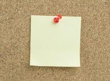 Sticky note. On cork board background royalty free stock photography