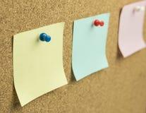 Sticky note. On cork board background stock photography