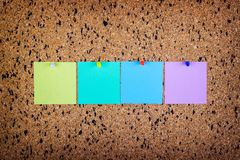 Sticky note on cork board, empty space for text Royalty Free Stock Photo
