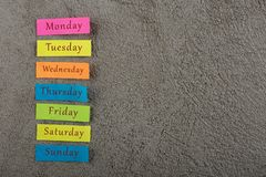 Sticky note with days of week on grey cement background. Monday, Tuesday, Wednesday, Thursday, Friday, Saturday, and Sunday. Many colorful sticky note with days stock photos
