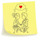 Sticky note with drawn teens couple in love Royalty Free Stock Image