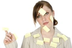 Sticky Note Girl. Beautiful young business woman covered in sticky notes royalty free stock photos