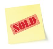 Sticky note indicating item is sold Royalty Free Stock Photos