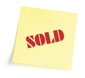 Sticky note indicating item is sold. Isolated Stock Image