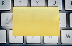 Sticky note on laptop keyboard Royalty Free Stock Photo