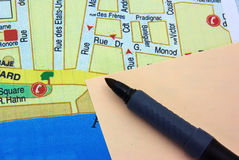 Sticky note with marker on a map Stock Photos