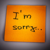Sticky Note Message isolated on white - I am sorry. Text i am sorry on short orange note paper Stock Images