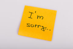 Sticky Note Message isolated on white - I am sorry Royalty Free Stock Images