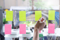 Sticky note paper reminder schedule board. Business people meeti. Ng and use post it notes to share idea on sticky note. Discussing - business, teamwork Royalty Free Stock Images
