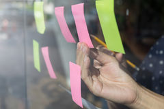 Sticky note paper reminder schedule board. Business people meeti. Ng and use post it notes to share idea on sticky note. Discussing - business, teamwork Stock Photography