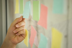 Sticky note paper on window,business man use post it note. royalty free stock photography