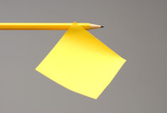 Sticky note on pencil Stock Images