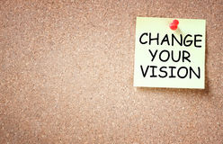 Sticky note with the phrase change your vision, room for text Stock Image