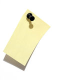 Sticky note and pin. Blank yellow sticky note and plack pin stock image
